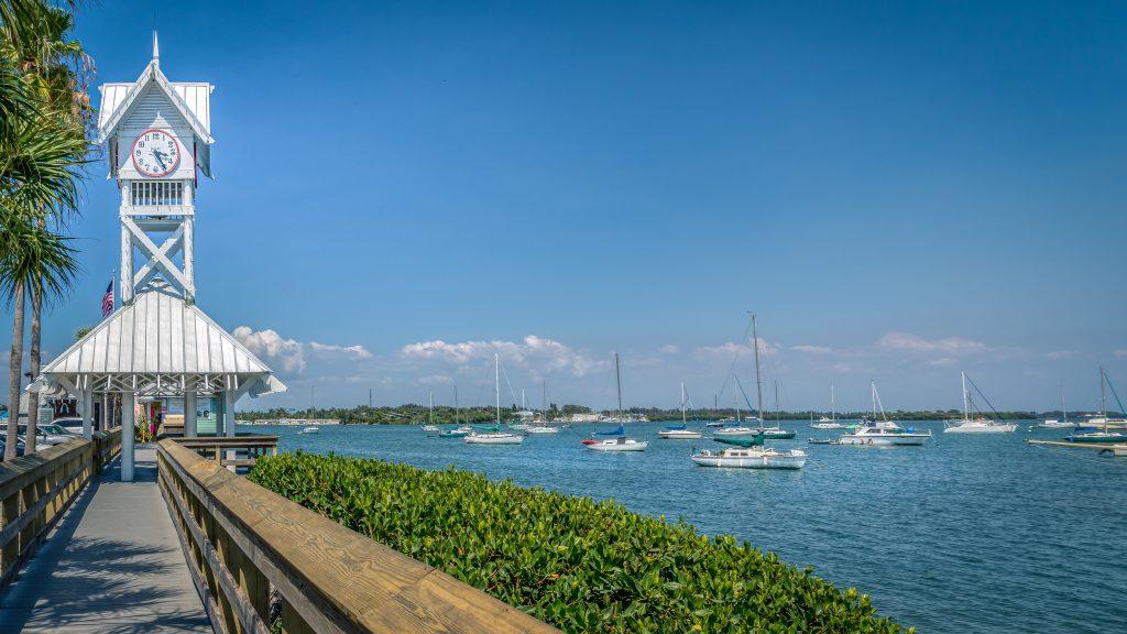 Sailboats docked near to the historic Bradenton Beach pier on Anna Maria Island, Florida.